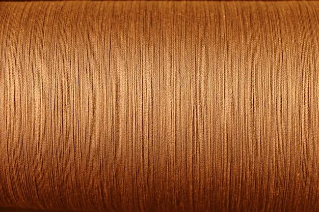Filo di cotone arancione dal telaio, astratto