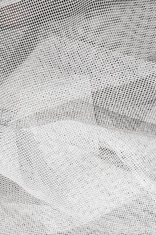 Fine bianca di struttura di tulle in su