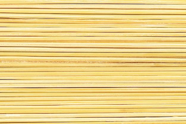 Fine gialla astratta astratta su struttura degli stuzzicadenti della natura
