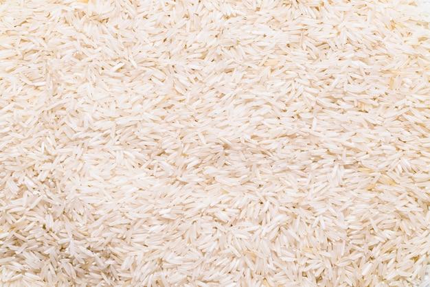 Fine lunga del riso bianco su, fondo strutturato