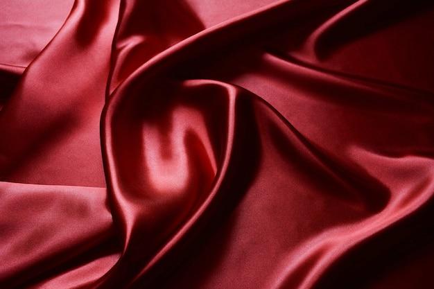 Fine rossa del tessuto su fondo