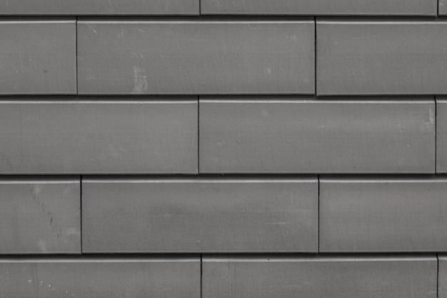 Flatlay della cupa superficie di mattoni in cemento grigio dell'edificio residenziale