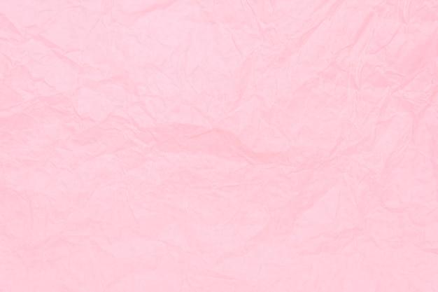 Foglio di carta sgualcito rosa fondo