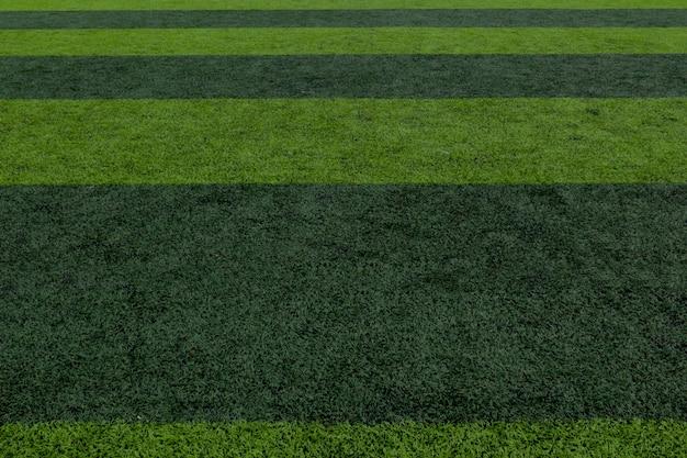 Fondo a strisce del campo di calcio, fondo del campo di calcio dell'erba verde