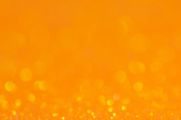 Fondo arancio del cerchio astratto di bokeh