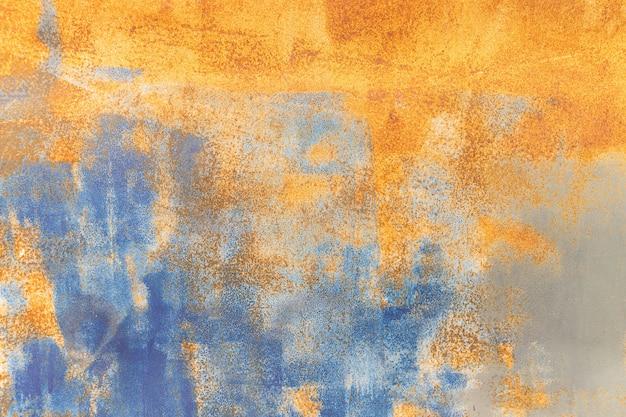 Fondo arrugginito del metallo arancio e struttura blu di lerciume del metallo