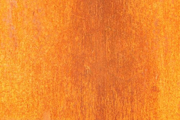 Fondo arrugginito del metallo arancio, struttura di lerciume del metallo
