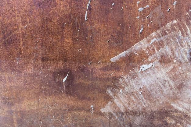 Fondo arrugginito indossato arancio di struttura del metallo