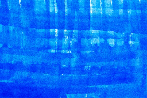 Fondo astratto dal blu dipinto sul muro di cemento