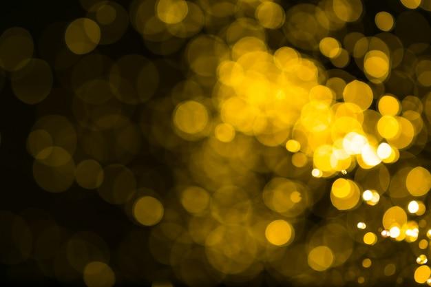 Fondo astratto del bokeh delle luci dorate