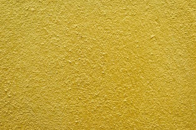Fondo astratto dell'oro, fondo del muro di cemento dell'oro, struttura dorata.