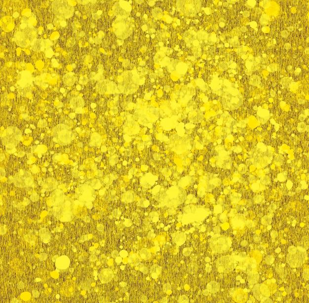 Fondo astratto dello splatter di struttura dell'oro