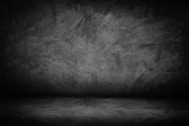 Fondo astratto di pendenza della parete del nero e dello studio della parete del cemento nero e scuro e grigio