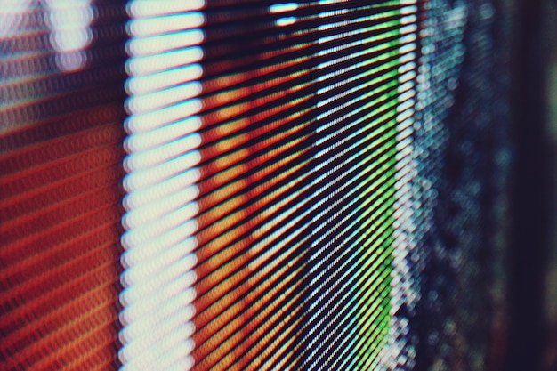 Fondo astratto luminoso colorato dell'estratto della parete del video del led smd alto vicino