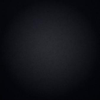 Fondo astratto nero scuro con trucioli di legno