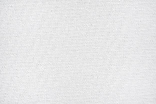 Fondo bianco del tessuto della tela di cotone del primo piano