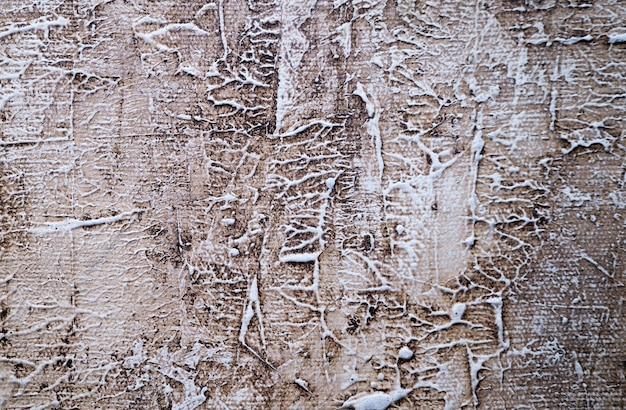 Fondo bianco dell'estratto di struttura della vecchia parete.