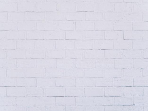Fondo bianco di stile del sottotetto del muro di mattoni
