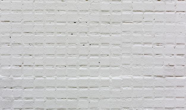 Fondo bianco di struttura della parete delle mattonelle