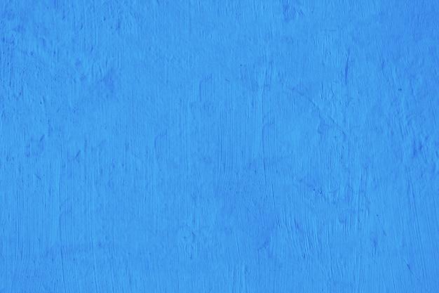 Fondo blu in bianco di struttura del muro di cemento