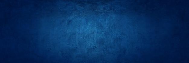 Fondo blu scuro della parete del cemento di struttura