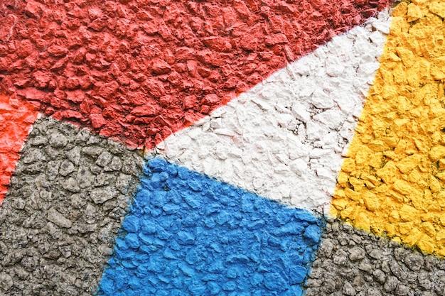 Fondo concreto multicolore - strutturato dipinto a mano di fantasia
