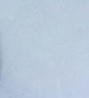 Fondo crudo bianco di struttura del muro di cemento