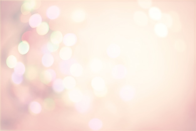 Fondo d'annata pastello rosa con boke leggero dei punti defocused