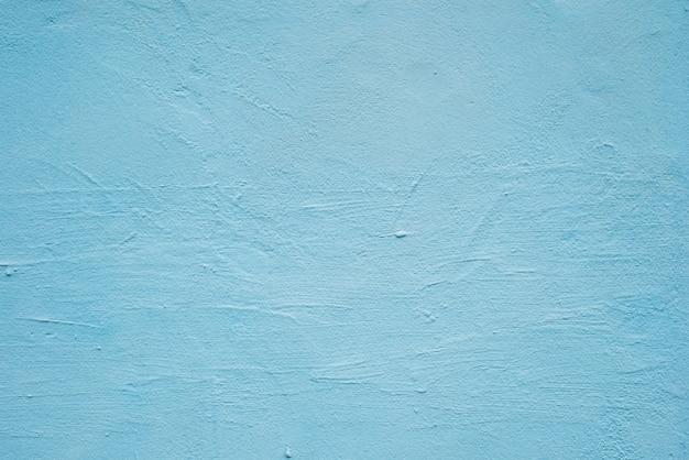 Fondo decorativo blu della parete del gesso di lerciume astratto con il modello di inverno.