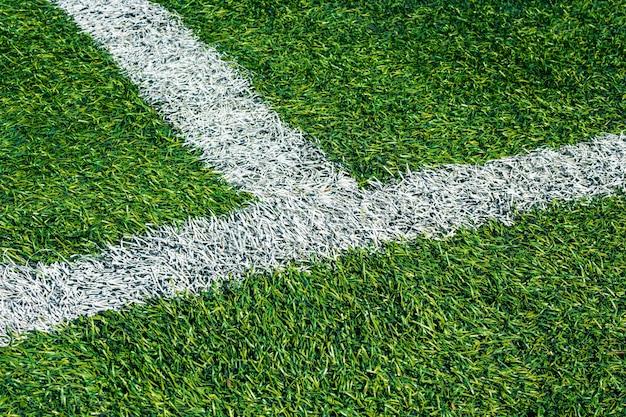 Fondo del campo di calcio dell'erba verde, vista superiore del primo piano