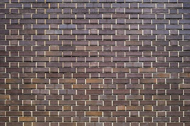 Fondo del mattone di struttura delle mattonelle della parete