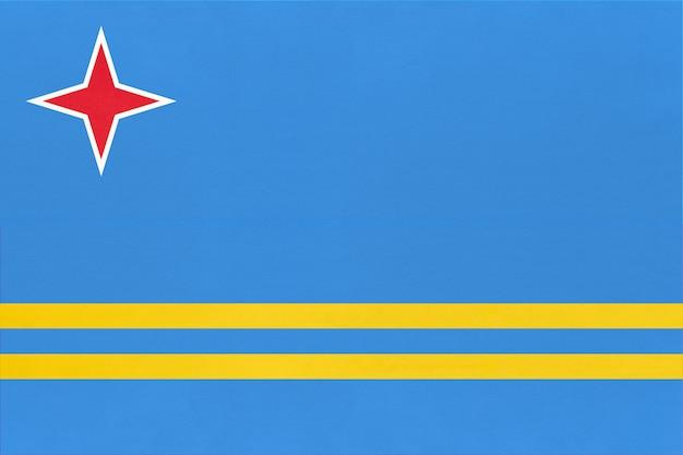 Fondo del tessuto della bandiera del tessuto nazionale di aruba. segno caraibico ufficiale dello stato.