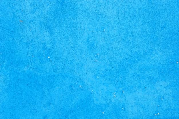 Fondo della parete dipinto cemento, colore pastello azzurro