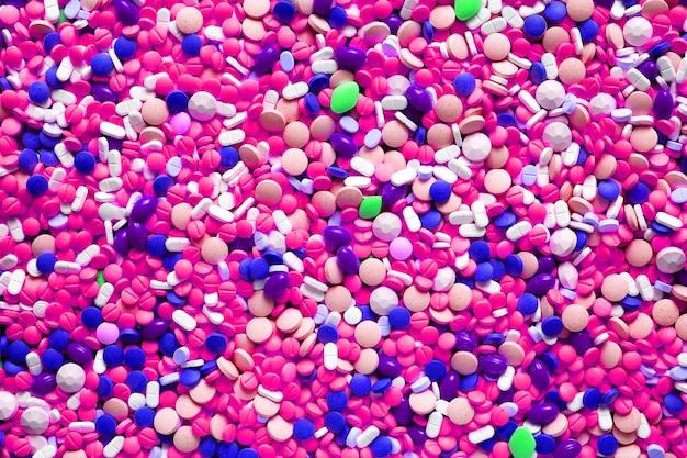 Fondo delle pillole della farmacia della medicina per il concetto di sanità medica, vista superiore, tono porpora magenta