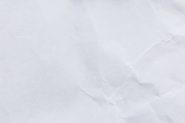 Fondo di carta riciclato bianco sgualcito per progettazione di massima di comunicazione e di istruzione di affari.