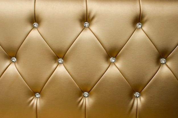 Fondo di cuoio dorato di lusso del primo piano