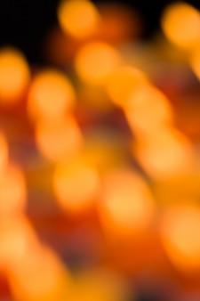 Fondo di festa di natale delle luci dorate vaghe scintillanti