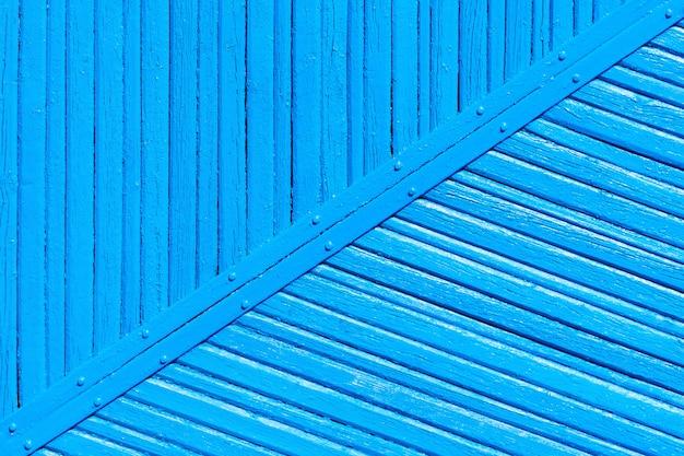 Fondo di legno del recinto della vecchia pittura blu indossata incrinata