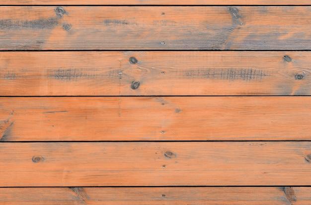 Fondo di legno verniciato dall'esterno della cabina. plancia di legno marrone del granaio