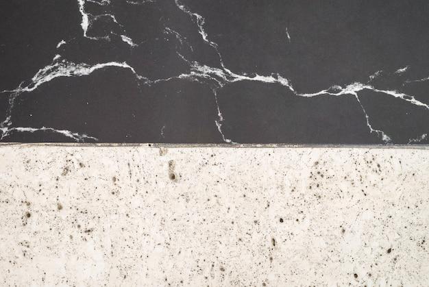 Fondo di marmo in bianco e nero di superficie del pavimento della superficie del primo piano