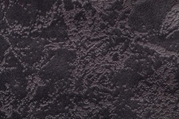 Fondo di marrone scuro da una materia tessile molle della tappezzeria, primo piano.