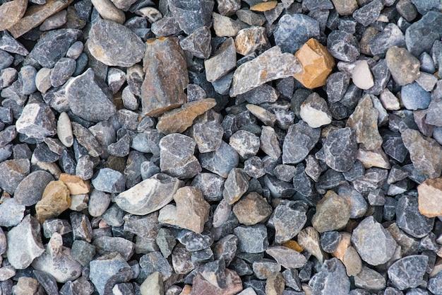 Fondo di pietra concreto, una fine su delle pietre concrete con il potere delle donne bianche delle perle dei ciottoli