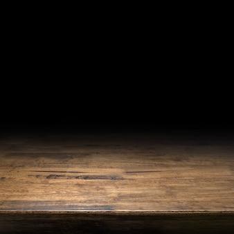 Fondo di prospettiva della tavola di legno di brown per esposizione o montaggio del prodotto