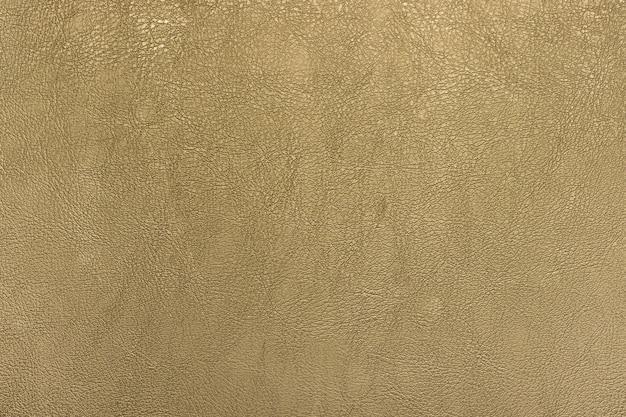 Fondo di struttura del cuoio di colore dell'oro scuro