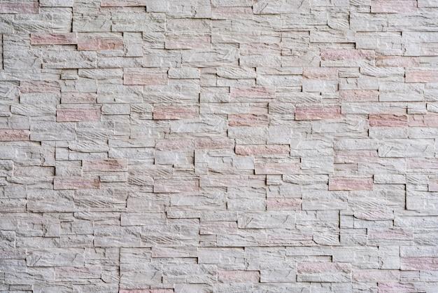 Fondo di struttura del mattone della parete di pietra bianca