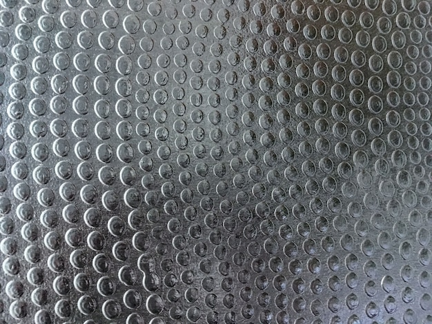 Fondo di struttura del metallo perforato grigio scuro
