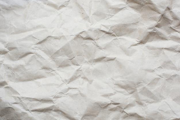 Fondo di struttura del modello della carta di tono di colore crema sgualcito