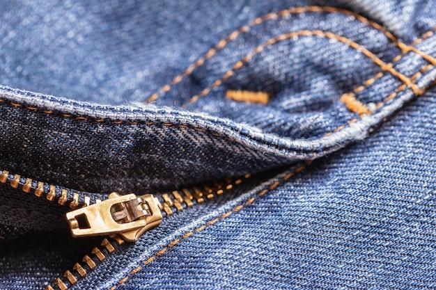 Fondo di struttura del tessuto dei jeans del denim con la chiusura lampo per progettazione