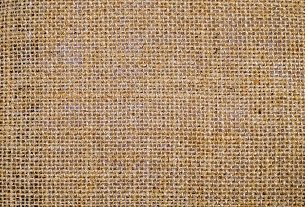 Fondo di struttura del tessuto della tela di iuta o della tela di sacco.