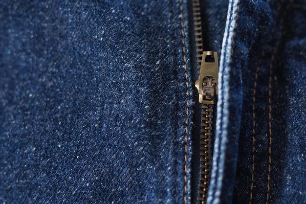 Fondo di struttura del tessuto delle zip jeans
